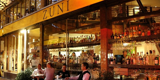 Patrons dine outside Zuni Cafe, a restaurant located at 1658